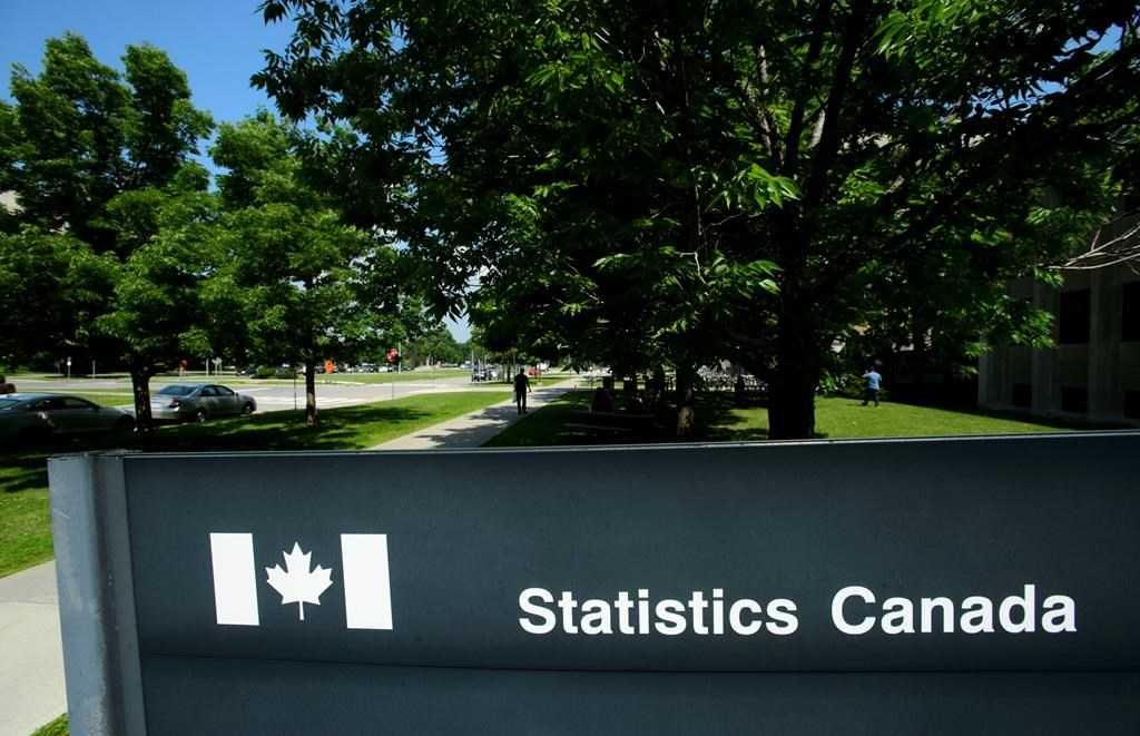 Statistics Canada building and signs are pictured in Ottawa on Wednesday, July 3, 2019. Statistics Canada will say today how inflation fared in June as more businesses reopened from pandemic-related lockdowns that put a damper on consumer spending. THE CANADIAN PRESS/Sean Kilpatrick.