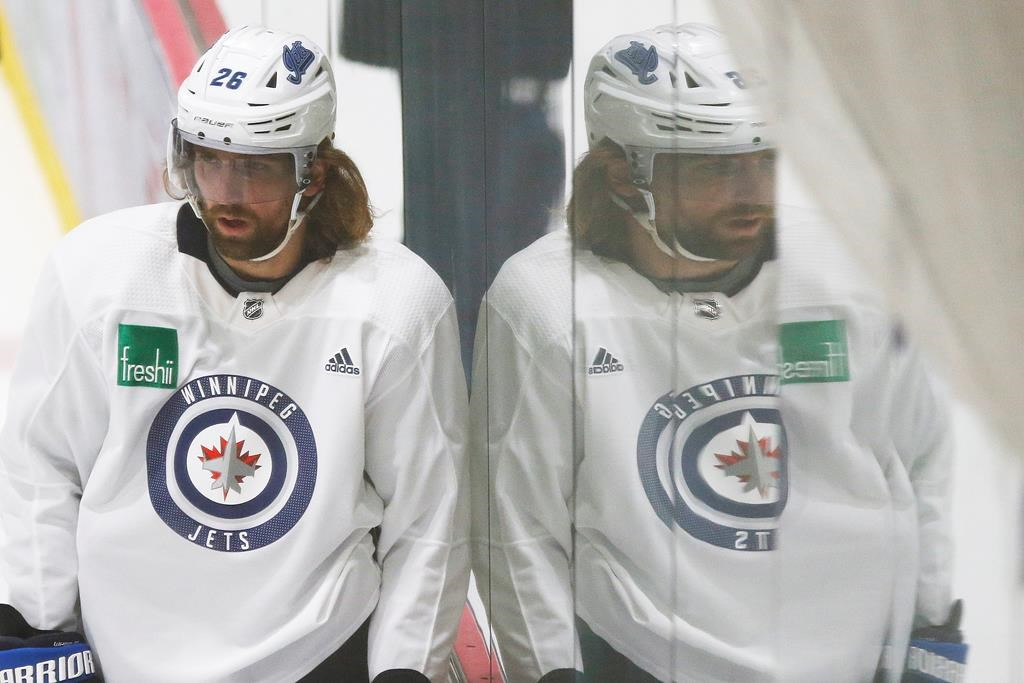 The Winnipeg Jets' Blake Wheeler (26) looks on during the first day of the Jets NHL summer training camp as the NHL reopens during COVID-19 in Winnipeg, Monday, July 13, 2020.
