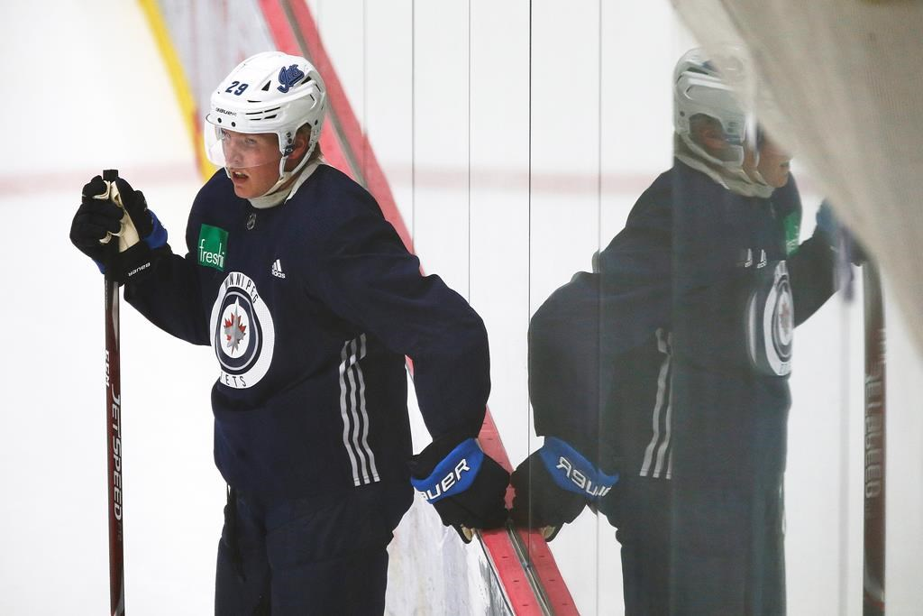 The Winnipeg Jets' Patrik Laine (29) looks on during the first day of the Jets NHL summer training camp as the NHL reopens during the COVID-19 pandemic in Winnipeg, Monday, July 13, 2020.