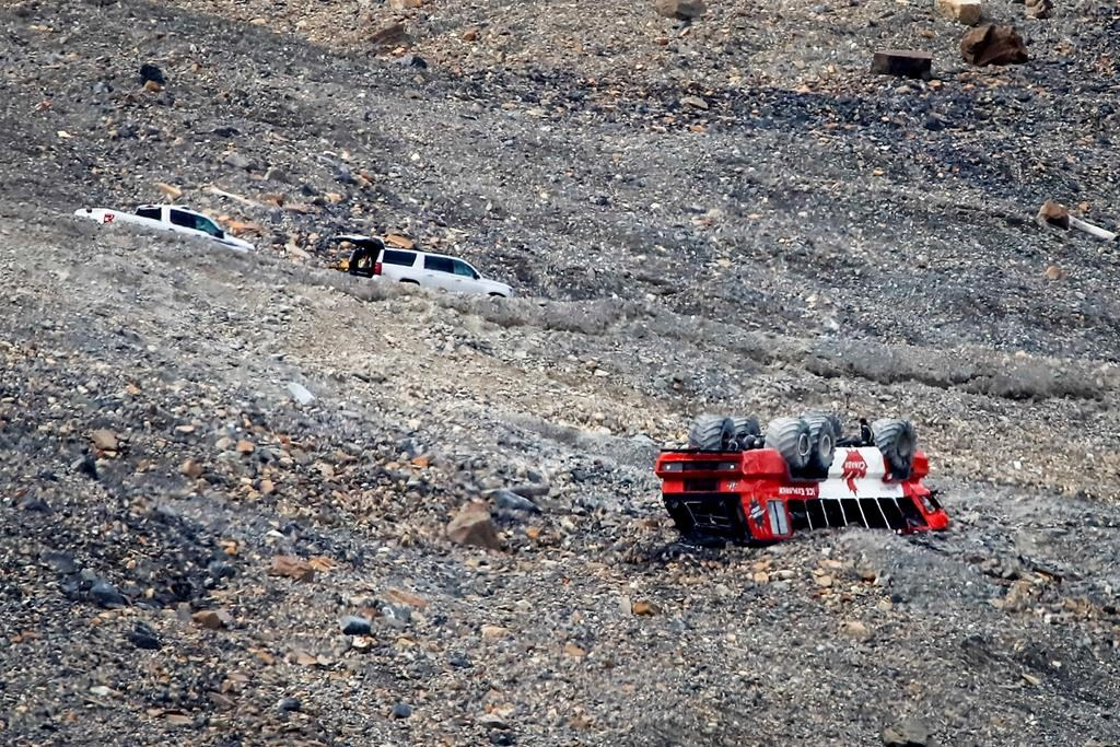 RCMP attend the scene of a sightseeing bus rollover at the Columbia Icefields near Jasper, Alta., Sunday, July 19, 2020.