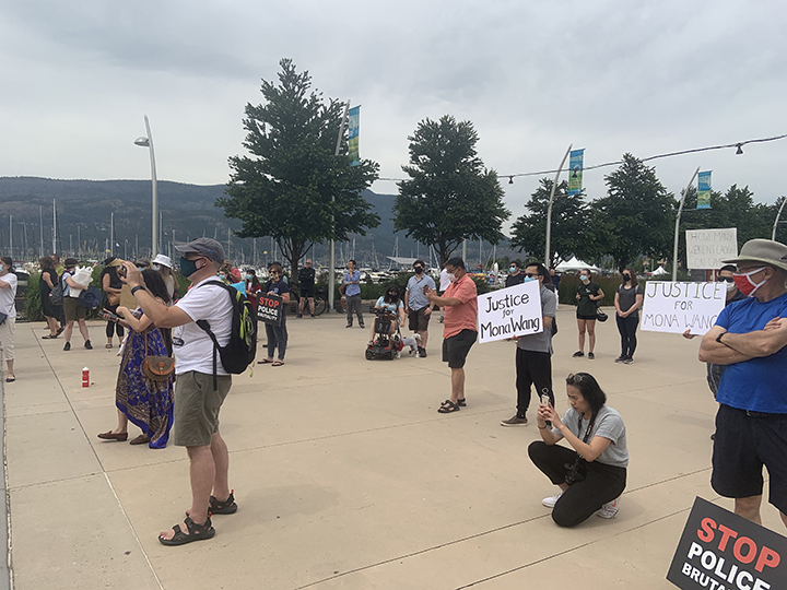 People attending a protest rally for Mona Wang in Kelowna on Saturday, July 11, 2020.