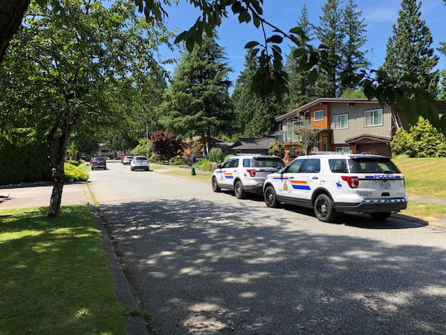 RCMP at the scene of a suspicious fire and death on the Surrey-Langley border on Wednesday, July 15, 2020.