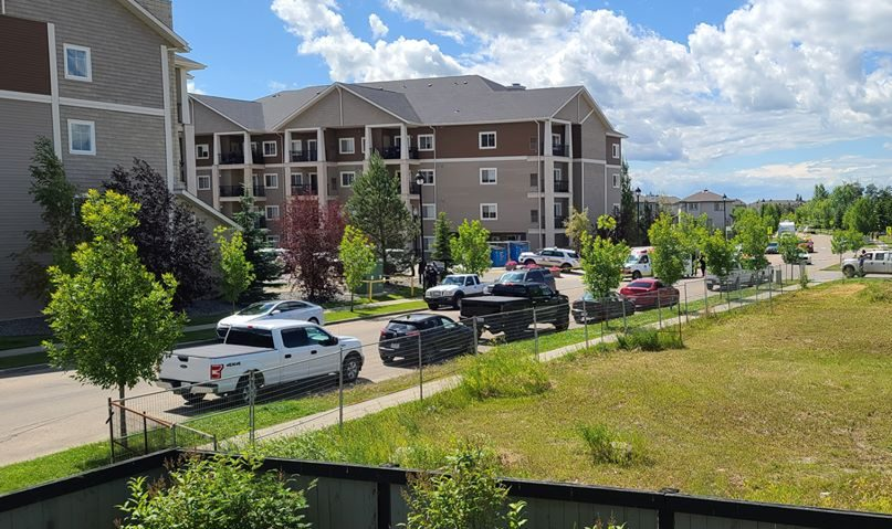 A police scene at an apartment complex at 105 Westhaven Drive in Leduc, Alta., on Friday, July 17, 2020.