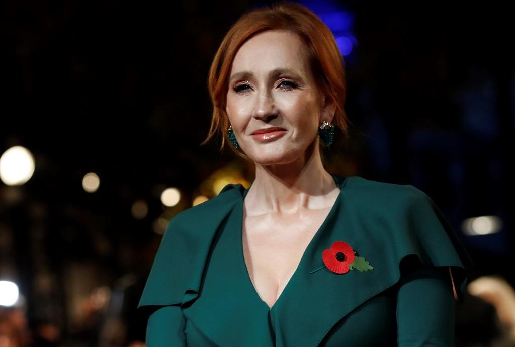Writer J.K. Rowling poses for the media at the world premiere of the film 'Fantastic Beasts: The Crimes of Grindelwald' in Paris.