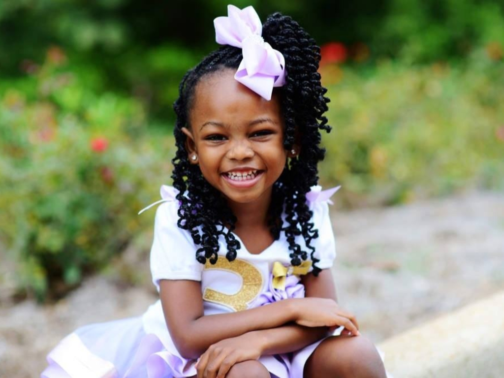 Madison Wilson, 7, is raising money to put multicultural books and crayons into classrooms. So far, she's raised more than US$14,500.