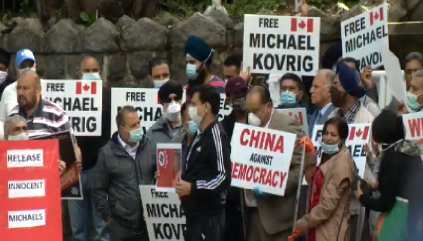 Protesters gather outside the Chinese embassy in Vancouver on Saturday, July 4, 2020.