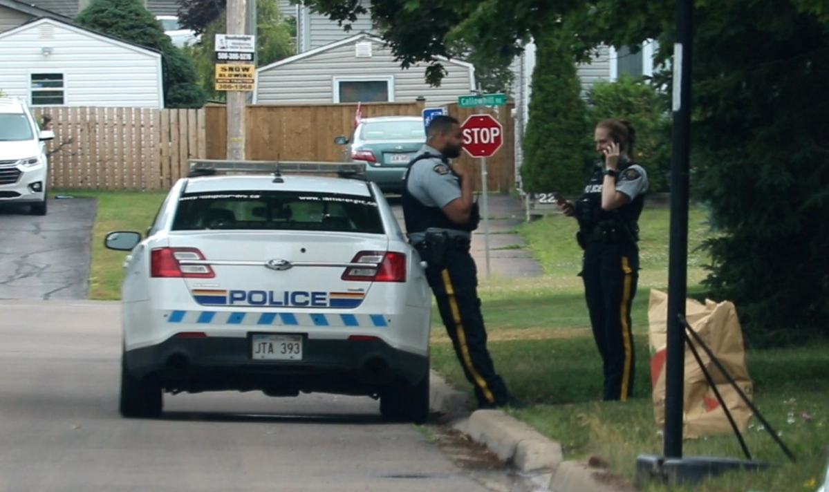 Codiac RCMP officers stand outside a crime scene in Moncton, New Brunswick, in this file photo.
