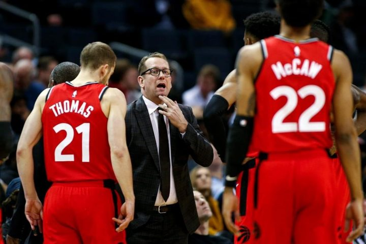 In this Jan. 8, 2020, file photo, Toronto Raptors coach Nick Nurse, center, gathers his team during a timeout in the first half of an NBA basketball game against the Charlotte Hornets in Charlotte, N.C.
