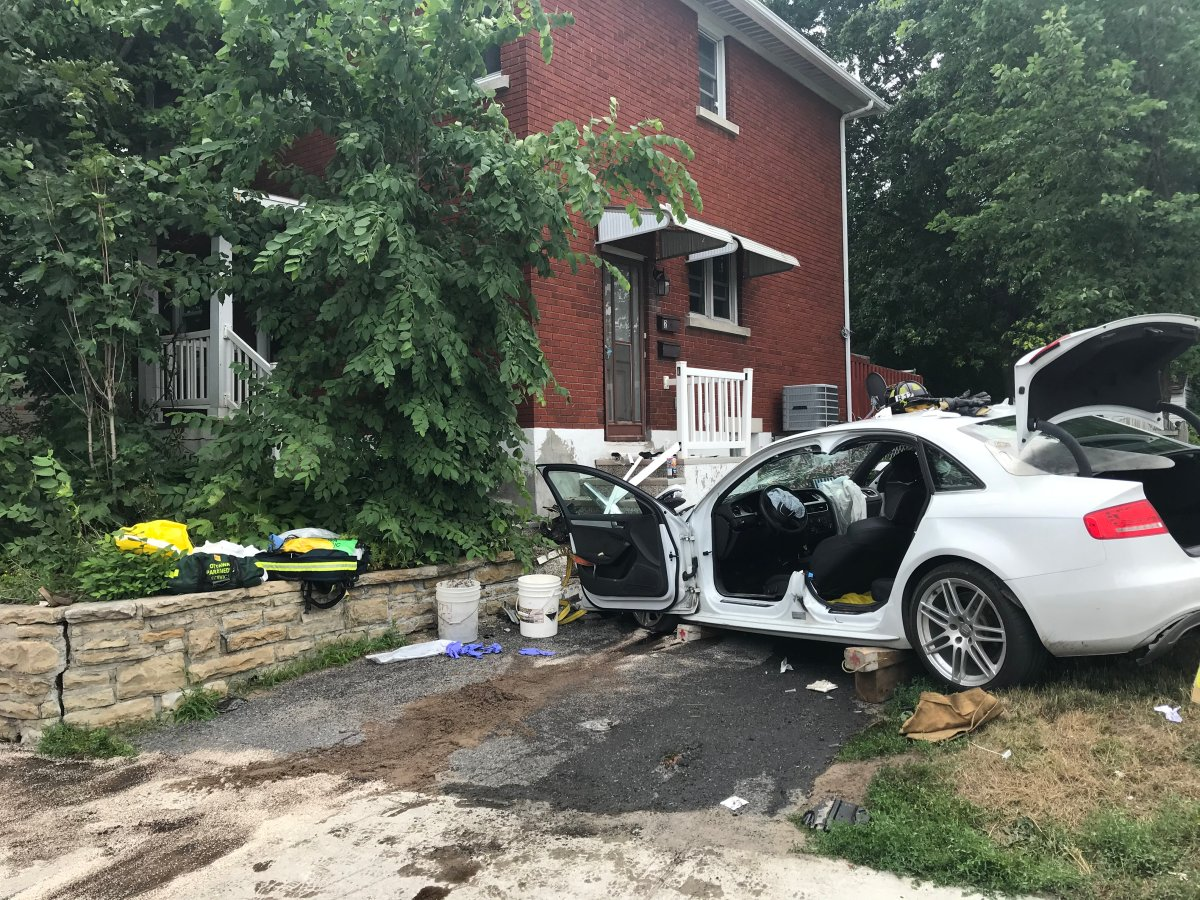 A car crashed into a Carling Avenue home on Monday afternoon. Ottawa fire crews extricated a woman inside the vehicle.