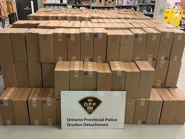 Hundreds of cases of illegal cigarettes Ontario Provincial Police say they discovered during a traffic stop Sunday.