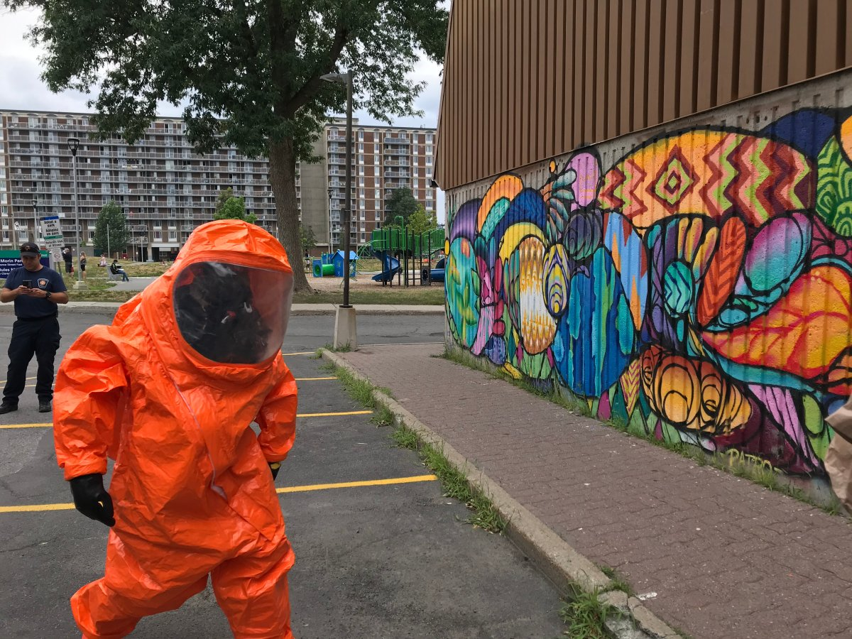 A member of the Ottawa Fire Services' hazmat team heads into Patro d'Ottawa to identify and isolate the source of a chlorine gas leak on Thursday, July 16, 2020.