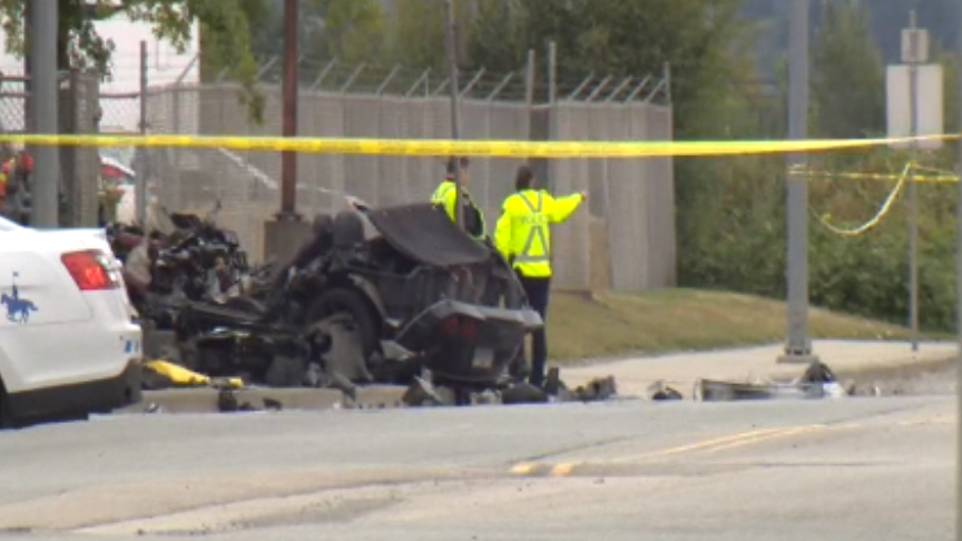 The wreckage of a Corvette is seen at the scene of a fatal crash that caused a gas leak and the evacuation of several businesses in Richmond on Saturday.