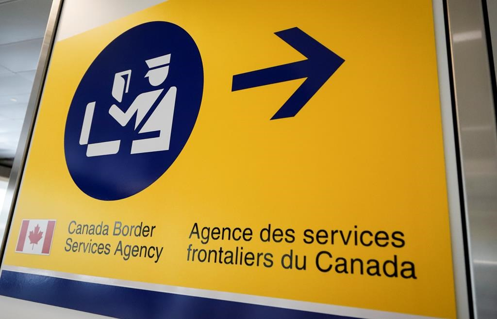 A Canada Border Services Agency (CBSA) sign is seen in Calgary, Alta., Thursday, Aug. 1, 2019. The federal auditor general says Canada's border agency has failed to promptly remove from Canada most of the people under orders to leave.THE CANADIAN PRESS/Jeff McIntosh.
