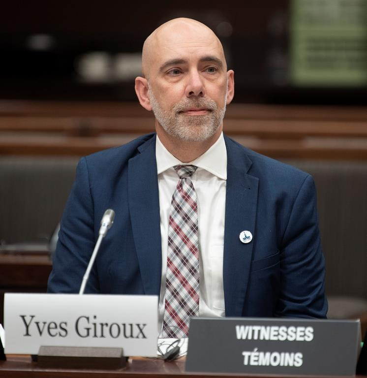 Parliamentary Budget Officer Yves Giroux waits to appear before the Commons Finance committee on Parliament Hill in Ottawa, Tuesday, March 10, 2020.