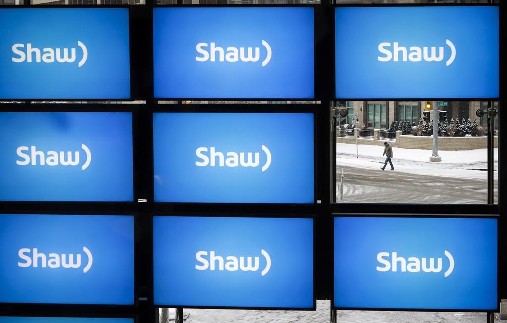 Shaw logos are on display at the company's annual meeting in Calgary, Jan. 17, 2019.