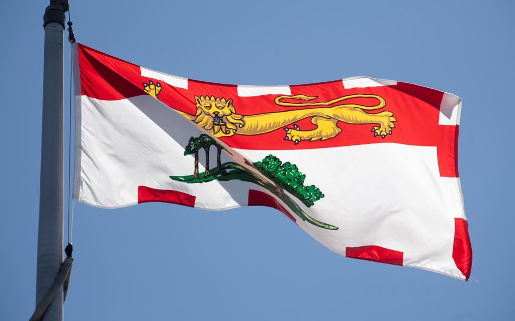 Prince Edward Island's provincial flag flies on a flag pole in Ottawa, Monday, July 6, 2020. Health officials in Prince Edward Island say there are now no active cases of COVID-19 in the province. THE CANADIAN PRESS/Adrian Wyld.
