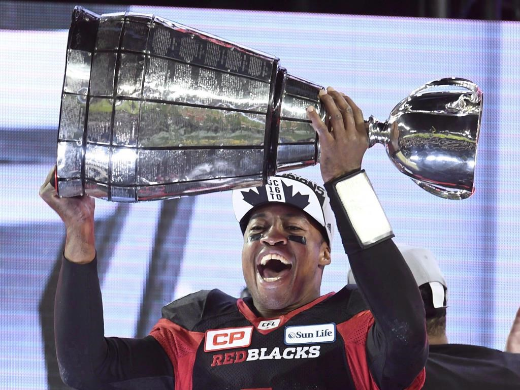 Ottawa Redblacks Henry Burris holds up the Grey Cup celebrating his team's win over the Calgary Stampeders in Toronto on Sunday, November 27, 2016. The 18-year veteran quarterback headlines the Canadian Football Hall of Fame's 2020 class that was unveiled Thursday. THE CANADIAN PRESS/Frank Gunn.