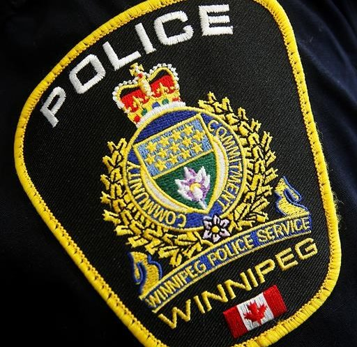 A Winnipeg Police Service shoulder badge on an officer.