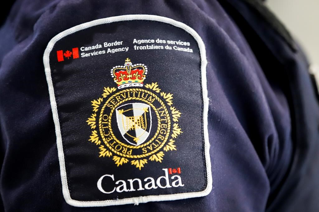 A Canada Border Services Agency (CBSA) patch is seen on an officer in Calgary, Alta., Thursday, Aug. 1, 2019.