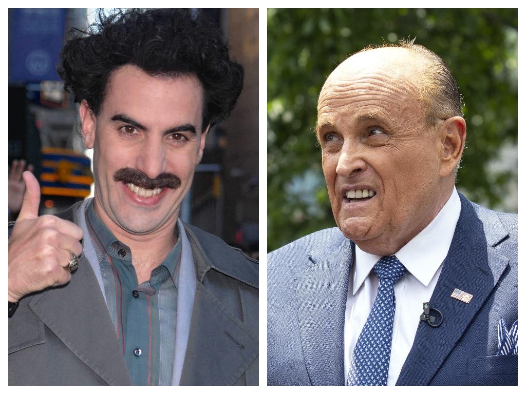 (L-R) British comedian Sacha Baron Cohen dressed as the fictional character Borat and former New York City mayor Rudy Giuliani.