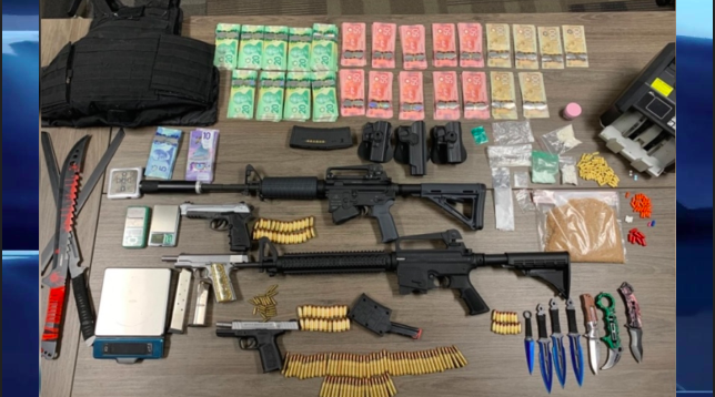 Police say they seized $35,500 in drugs, $24,500 in cash, as well as guns, scales, a bullet proof vest and several knives.