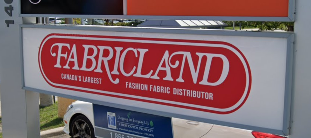 The Fabricland sign out front of the Merivale Road location where a man says he was unable to enter without a mask despite having a medical exemption.