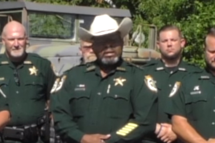 Clay County Sheriff Darryl Daniels, centre, issues a warning to protesters in this image from video on June 30, 2020.