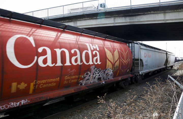 A Canadian Pacific Rail train hauling grain passes through Calgary, Thursday, May 1, 2014.