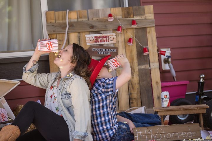 """A Calgary family poses for a Stampede themed """"Porch-rait"""" amid COVID-19 physical distancing policies."""