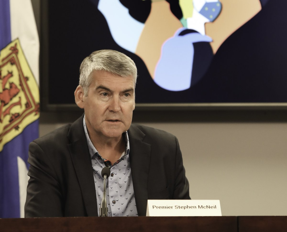 Nova Scotia Premier Stephen McNeil addresses reporters on July 31, 2020, the first day masks became mandatory in public indoor spaces in the province. He was wearing a mask before he sat down at his desk.