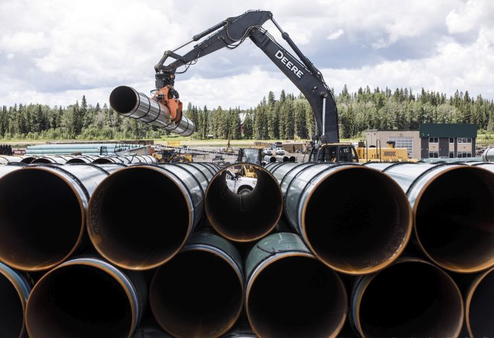 Pipe for the Trans Mountain pipeline is unloaded in Edson, Alta. on Tuesday June 18, 2019.