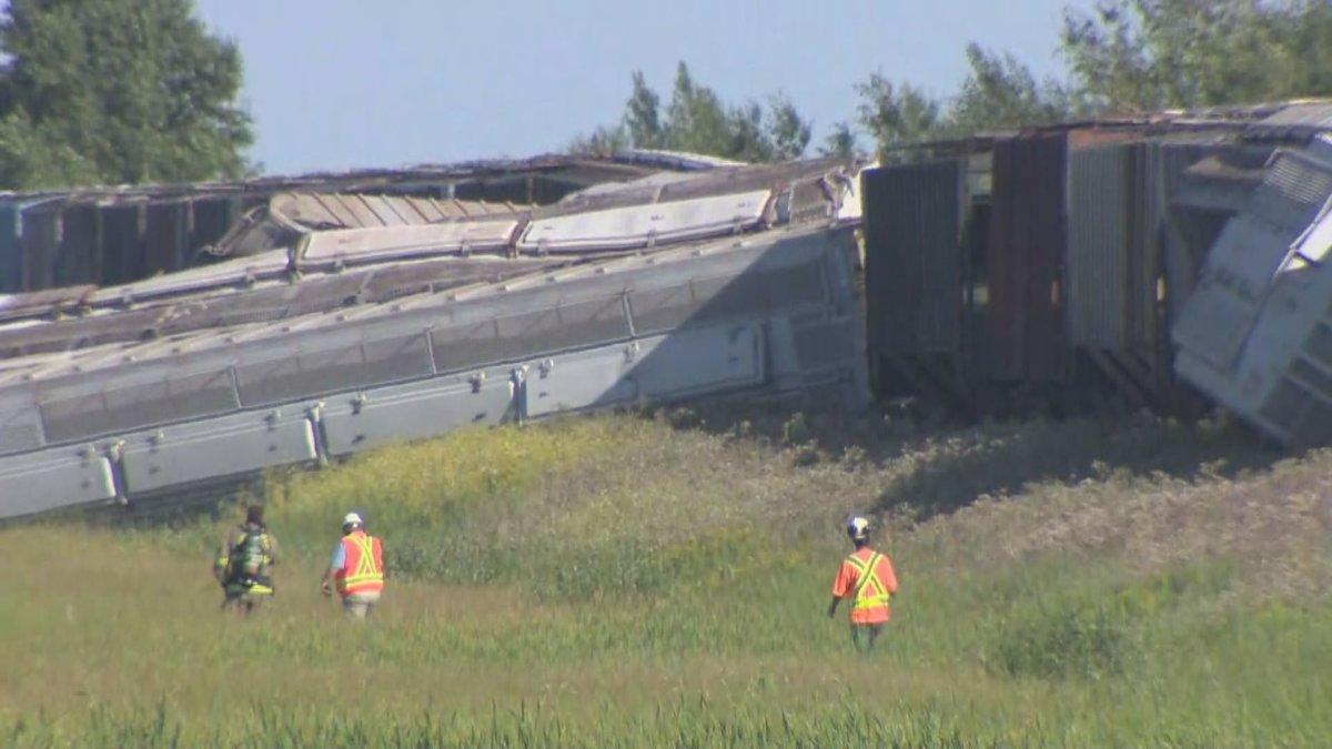 Crews inspect the damage after a train derailed near Deacon's Corner, east of Winnipeg, Thursday.