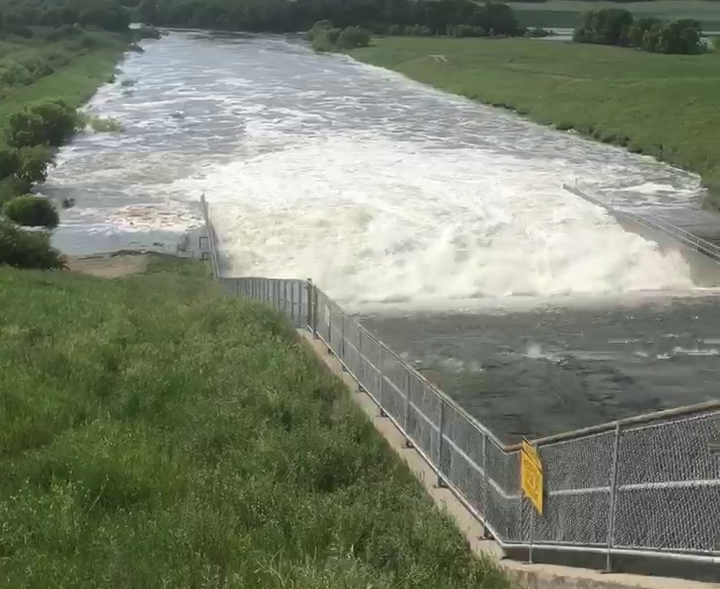 Water flows through the Rivers Dam and down the Little Saskatchewan River in Manitoba Sunday, July 1, 2020.