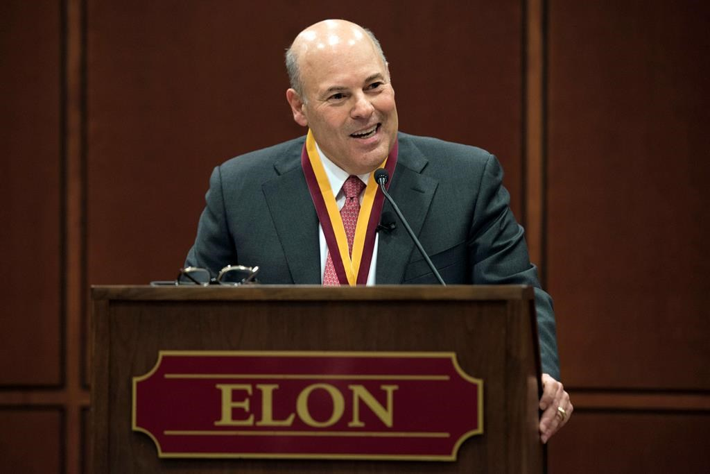 FILE - In this March 1, 2017, file photo, Elon Trustee Louis DeJoy is honored with Elon's Medal for Entrepreneurial Leadership in Elon. N.C.