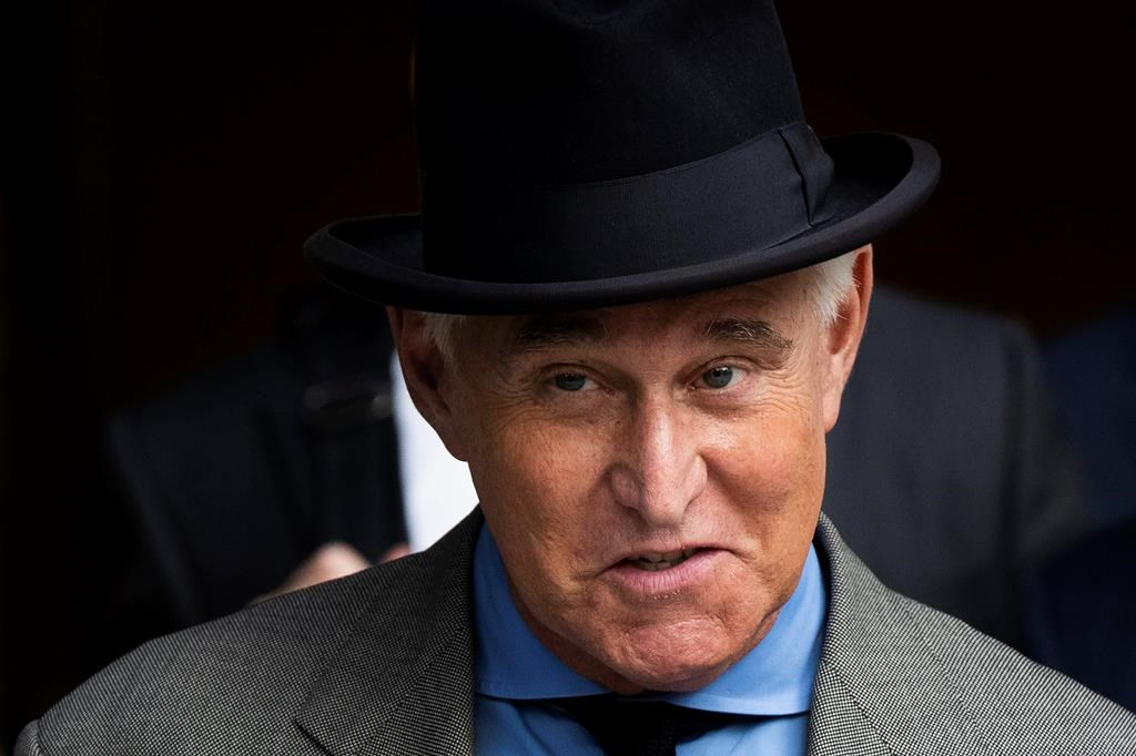 FILE - In this Nov. 12, 2019, file photo Roger Stone leaves federal court in Washington. A federal judge is giving Stone, a longtime ally and confidant of President Donald Trump, an additional two weeks before he must report to serve his federal prison sentence.