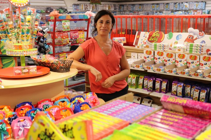 Sparkles owner, Claire Himo stands at her favorite section of the shop on Tuesday, Aug. 4, 2020.