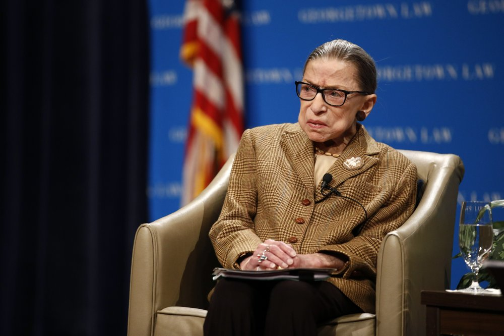 In this Feb. 10, 2020, file photo U.S. Supreme Court Associate Justice Ruth Bader Ginsburg speaks during a discussion on the 100th anniversary of the ratification of the 19th Amendment at Georgetown University Law Center in Washington.