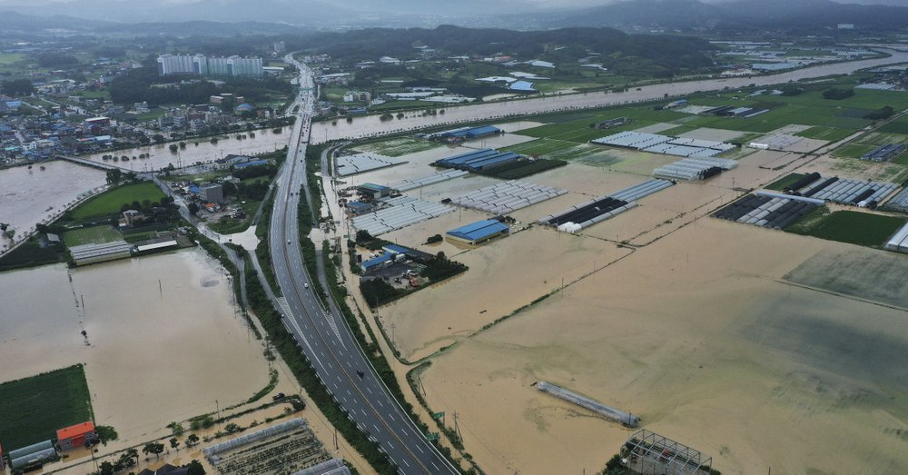 Agricultural lands are inundated with flood waters after heavy rains in Anseong, South Korea, Sunday, Aug. 2, 2020. South Korean Meteorological Administration issued a warning of heavy rain for Seoul and central area.