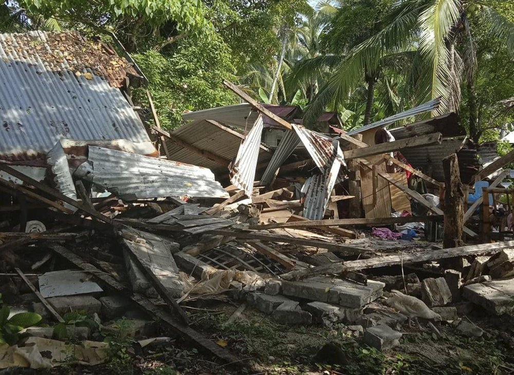 In this photo provided by the Philippine Red Cross, a toppled house is seen after a quake struck in Cataingan, Masbate province, central Philippines on Tuesday Aug. 18, 2020. A powerful and shallow earthquake struck a central Philippine region Tuesday, prompting people to dash out of homes and offices but there were no immediate reports of injuries or major damage.