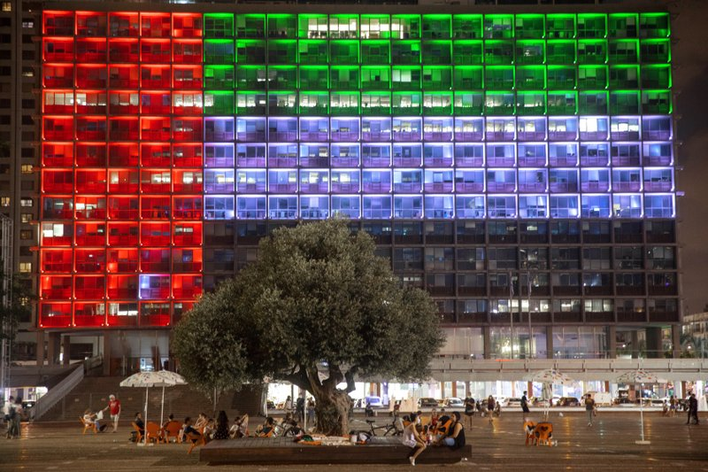 FILE - In this Aug. 13, 2020, file photo, Tel Aviv City Hall is lit up with the flag of the United Arab Emirates as UAE and Israel announced they would be establishing full diplomatic ties, in Tel Aviv, Israel.Iran's powerful Revolutionary Guard vowed on Saturday, Aug. 15, 2020 that there would be dangerous consequences for the United Arab Emirates after it announced a historic deal with Israel to open up diplomatic relations.