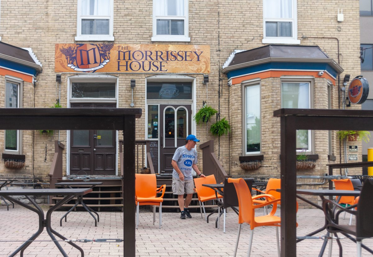 Workers at The Morrissey House in London, Ont., in June 2020. The eatery is among those receiving $1,000 as part of a fund aimed at helping bars and restaurants in the region reopen amid the pandemic.