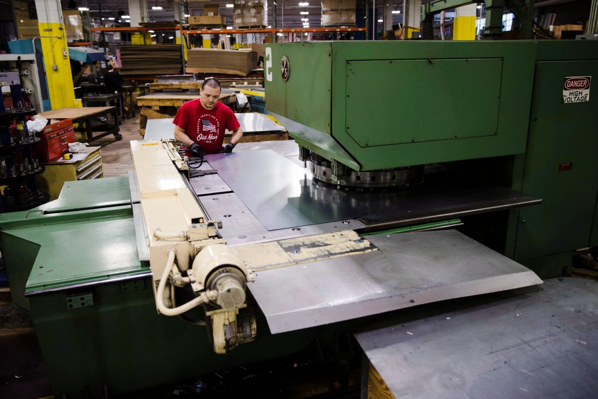 In this Thursday, Oct. 18, 2018, photo Jose Hernandez operates a turret press at the Howard McCray's commercial refrigeration manufacturing facility in Philadelphia.