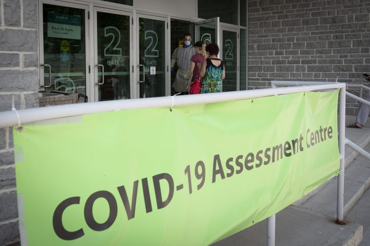 People enter the COVID-19 assessment centre at Leon's Centre in Kingston, Ontario.