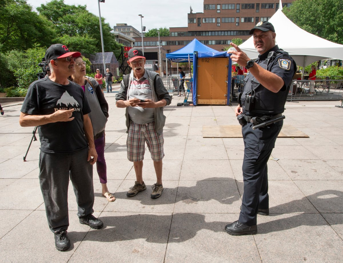 FILE: Const. Raphael Bergeron speaks with citizens as Montreal police launch a pilot project to help the vulnerable, Tuesday, July 21, 2020 in Montreal.