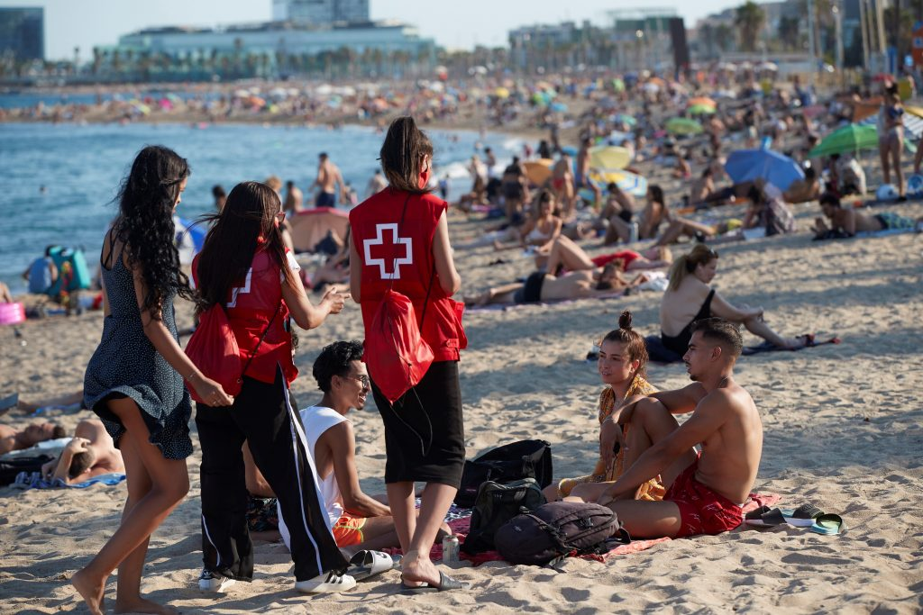 Spanish Red Cross members take part in a campaign to raise awareness among young people to avoid further spread of the coronavirus COVID-19 virus in Barcelona, Catalonia, Spain, 07 August 2020.