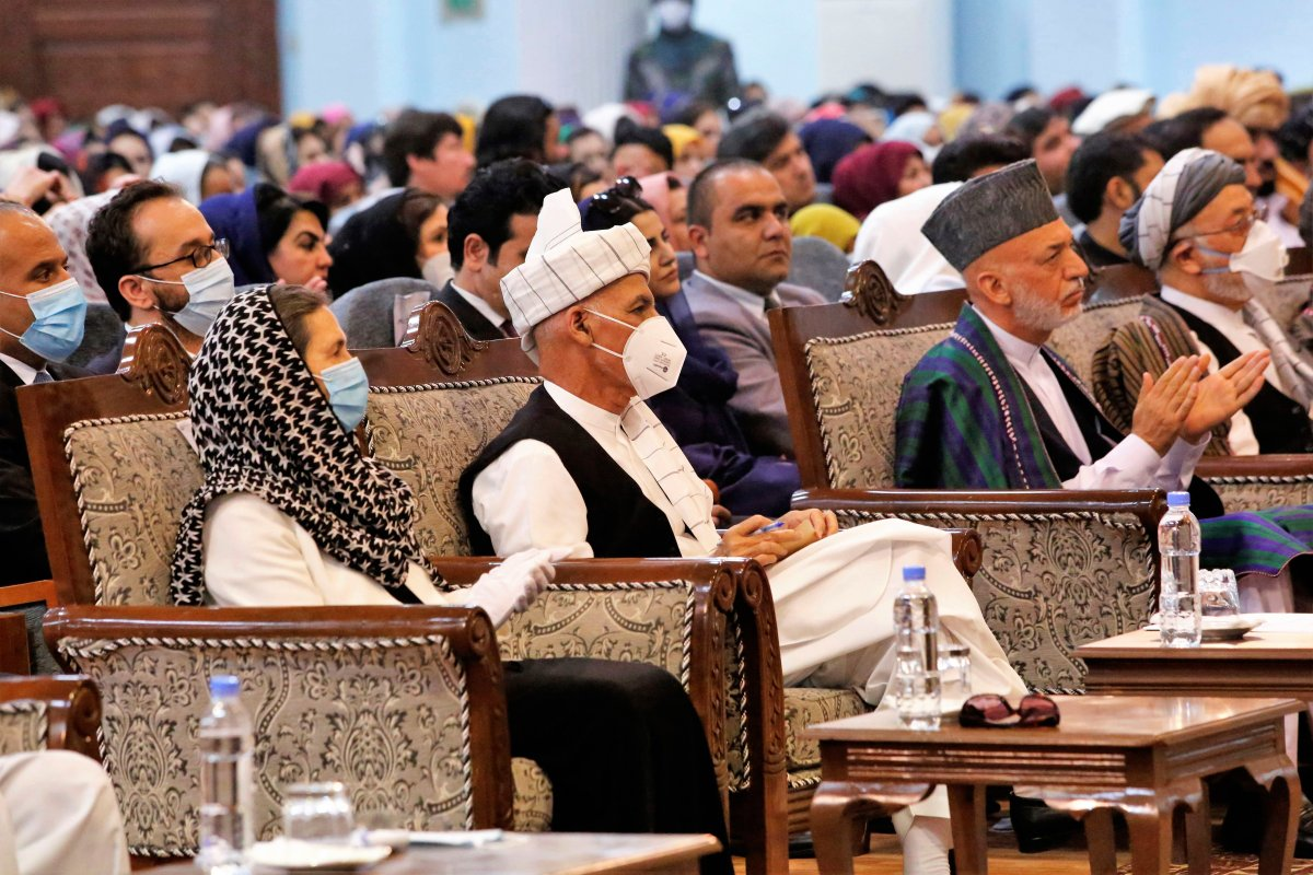 Afghan President Ashraf Ghani, center left, wears a protective face mask to help curb the spread of the coronavirus, on the last day of an Afghan Loya Jirga or traditional council, in Kabul, Afghanistan, Aug. 9, 2020.