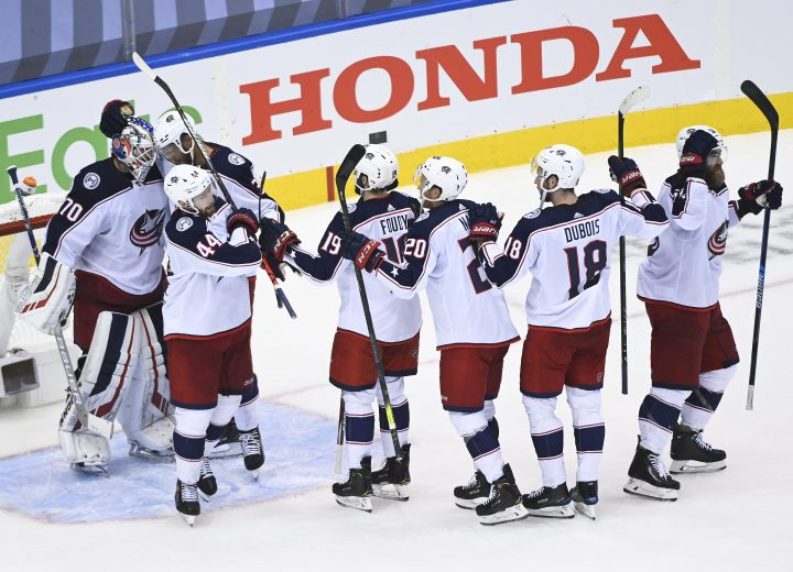 Columbus Blue Jackets goaltender Joonas Korpisalo (70) celebrates his shutout win with teammates after eliminating the Toronto Maple Leafs during third period NHL Eastern Conference Stanley Cup playoff action in Toronto on Sunday, August 9, 2020.
