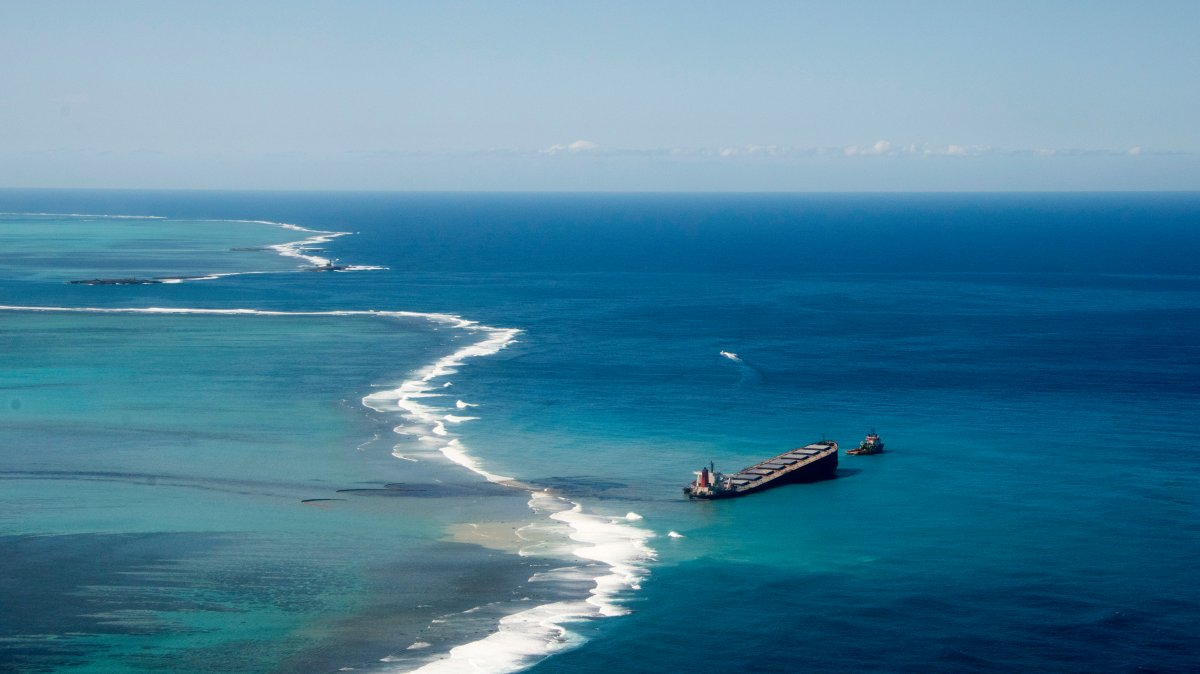 This photo provided by the French Army shows oil leaking from the MV Wakashio, a bulk carrier ship that ran aground off the southeast coast of Mauritius, Tuesday Aug.11, 2020. Thousands of students, environmental activists and residents of Mauritius were working around the clock trying to reduce the damage to the Indian Ocean island from an oil spill after a tanker ran aground on a coral reef. An estimated 1 ton of oil from the Japanese ship's cargo of 4 tons has already escaped into the sea, officials said.