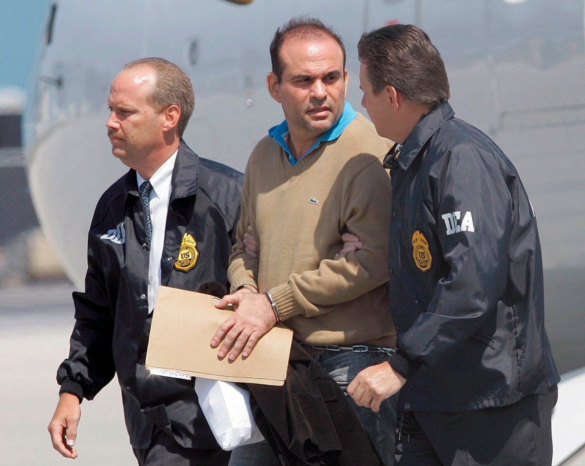 In this May 13, 2008 file photo, Colombian paramilitary warlord Salvatore Mancuso is escorted by U.S. DEA agents upon his arrival to Opa-locka, Florida.