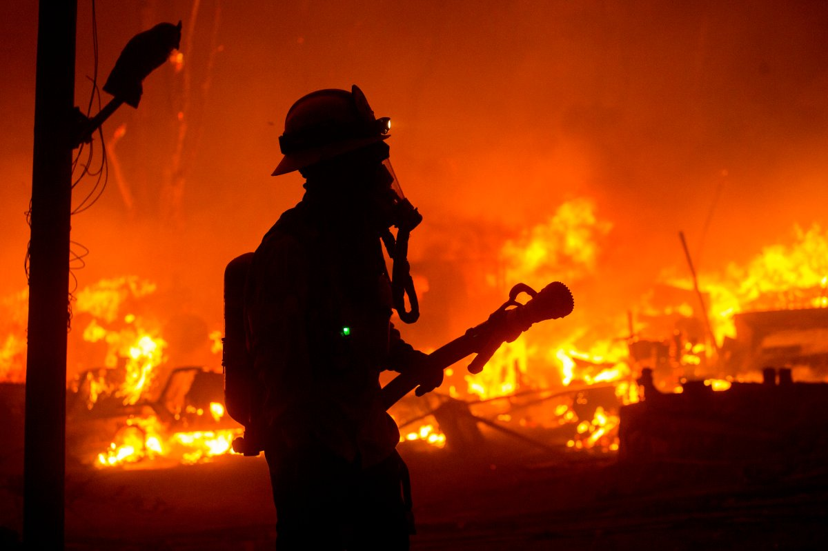 A firefighter watches the Lake Hughes fire in Angeles National Forest on Wednesday, Aug. 12, 2020, north of Santa Clarita, Calif. (AP Photo/Ringo H.W. Chiu)